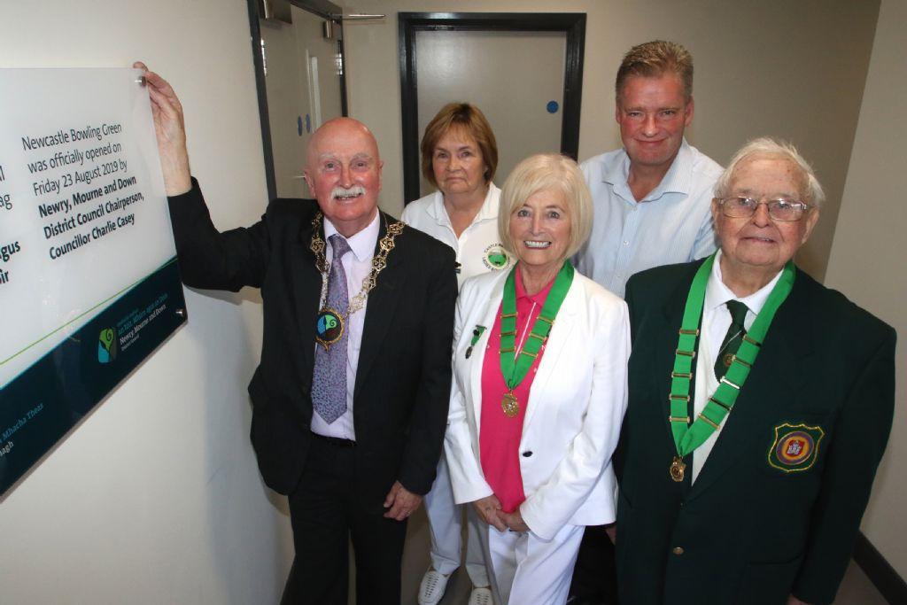 chairman and group at plaque