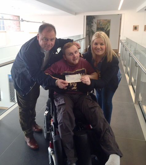 Council Chair Presents Donation to Local Lad Declan